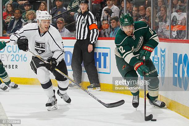 David Jones of the Minnesota Wild moves the puck against Brayden McNabb of the Los Angeles Kings during the game on March 22 2016 at the Xcel Energy...