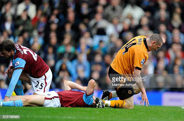 David Jones of Wolverhampton Wanderers celebrates after James Milner of Aston Villa lies dejected on the ground after scoring an own goal to make it...