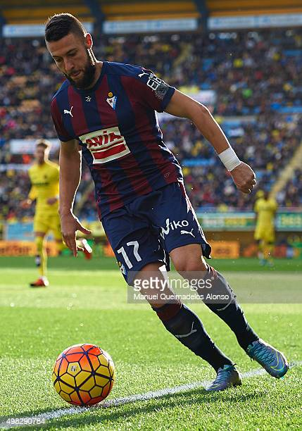 David Junca of Eibar runs with the ball during the La Liga match between Villarreal CF and SD Eibar at El Madrigal stadium on November 22 2015 in...