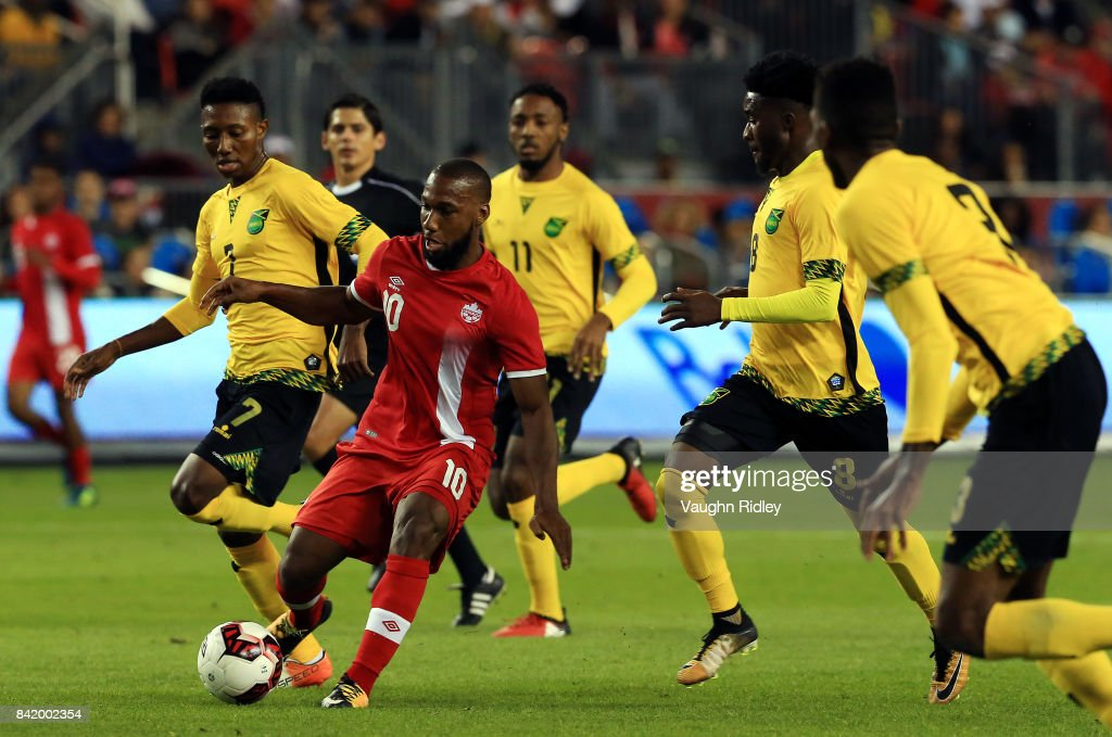 David Junior Hoilett #10 of Canada battles for the ball with Devon Williams #7 and Oniel Fisher #8 of Jamaica during the second half of an International Friendly match at BMO Field on September 2, 2017 in Toronto, Canada.