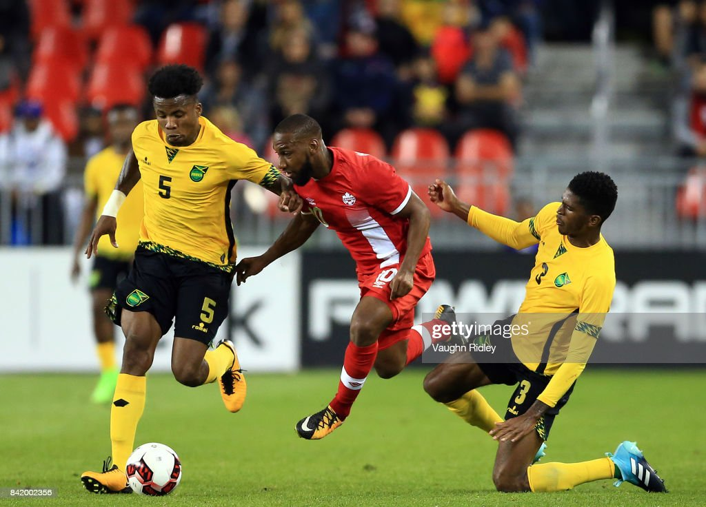 David Junior Hoilett #10 of Canada is tackled by Alvas Powell #5 and Damion Lowe #3 of Jamaica during the second half of an International Friendly match at BMO Field on September 2, 2017 in Toronto, Canada.