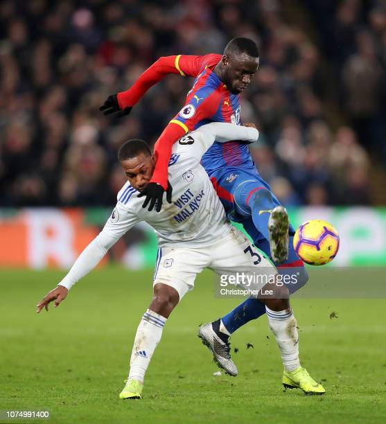 David Junior Hoilett of Cardiff City is challenged by Cheikhou Kouyate of Crystal Palace during the Premier League match between Crystal Palace and...
