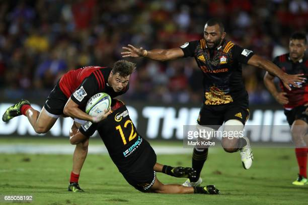David Kaetau Havili of the Crusaders is tackled by Anton LienertBrown of the Chiefs during the round 13 Super Rugby match between the Chiefs and the...