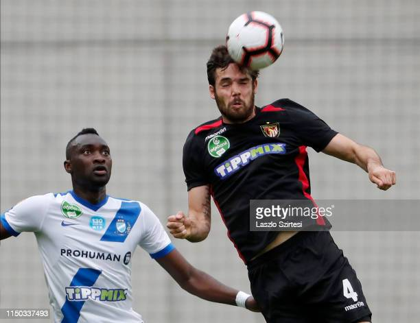 David Kalnoki-Kis of Budapest Honved wins the ball in the air from Ulysse Diallo of MTK Budapest during the Hungarian OTP Bank Liga match between MTK...