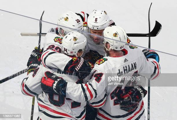 David Kampf of the Chicago Blackhawks celebrates a gaol against the Vegas Golden Knights with teammates during the second period in Game One of the...