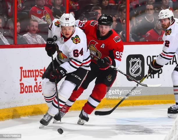 David Kampf of the Chicago Blackhawks pulls the puck away from Matt Duchene of the Ottawa Senators at Canadian Tire Centre on October 4 2018 in...