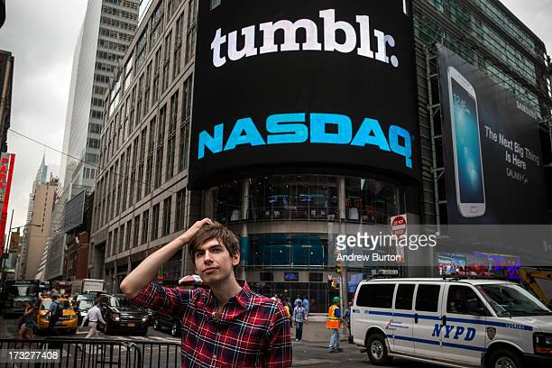 David Karp founder of the microblogging site Tumblr stands in Times Square after opening the NASCAQ Exchange on July 11 2013 in New York City Tumblr...