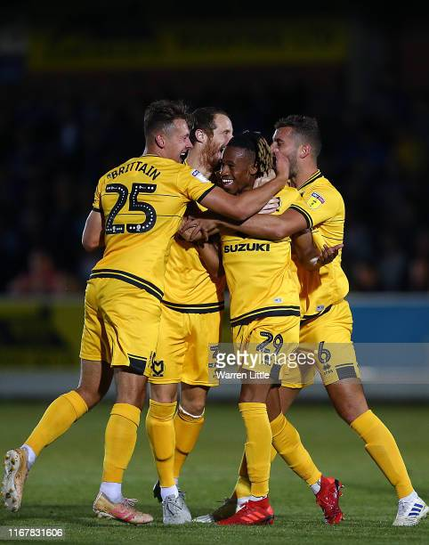 David Kasumu of MK Dons is congratulated after scoring during the Carabao Cup First Round match between AFC Wimbledon and Milton Keynes at The Cherry...