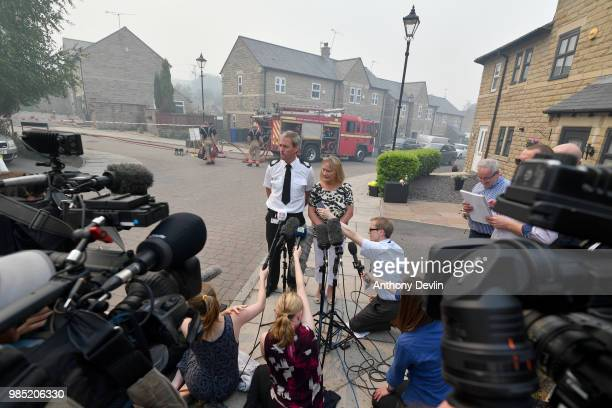 David Keelan from Greater Manchester Fire and Rescue speaks to media on Calico Close as a large wildfire sweeps across the moors between Dovestones...