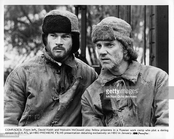 David Keith and Malcolm McDowell play fellow prisoners plotting for an escape in a scene from the film 'Gulag', 1985.