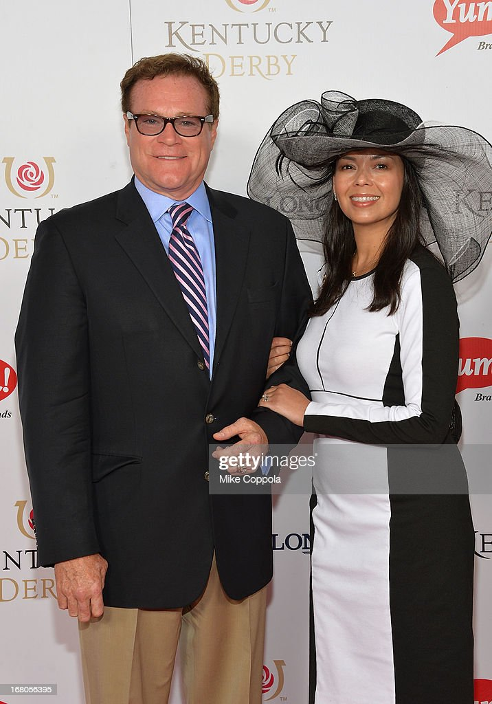 David Keith and Nancy Clark celebrate the 139th Kentucky Derby with Moet & Chandon at Churchill Downs on May 4, 2013 in Louisville, Kentucky.