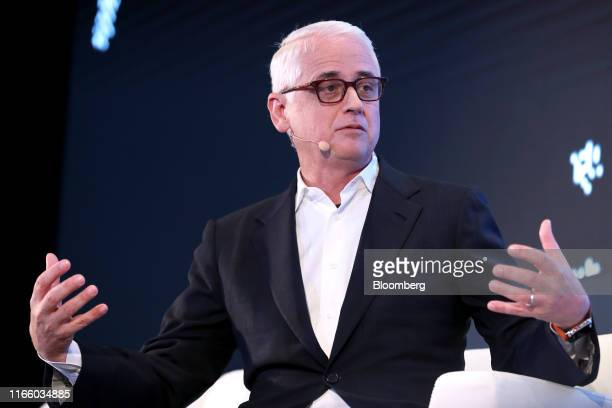 David Kenny chief executive officer of Nielsen Holdings Plc gestures as he speaks during the Bloomberg Sooner Than You Think technology event in...