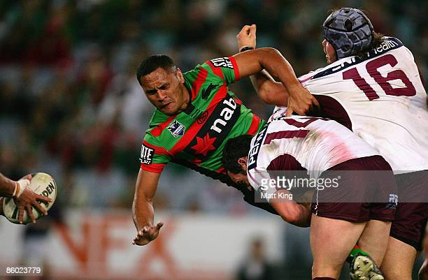 David Kidwell of the Rabbitohs offloads the ball after a heavy tackle during the round six NRL match between the South Sydney Rabbitohs and the Manly...