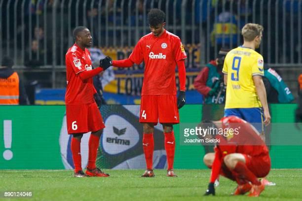 David Kinsombi and Aaron Seydel of Kiel after the Second Bundesliga match between Eintracht Braunschweig and Holstein Kiel at Eintracht Stadion on...