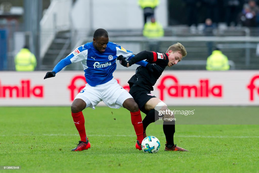 David Kinsombi Of Kiel And Joshua Mees Of Regensburg Battle For The News Photo Getty Images