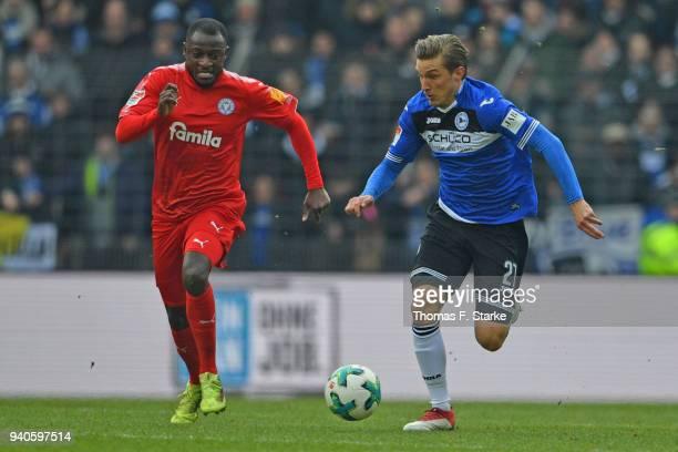 David Kinsombi of Kiel and Konstantin Kerschbaumer of Bielefeld fight for the ball during the Second Bundesliga match between DSC Arminia Bielefeld...