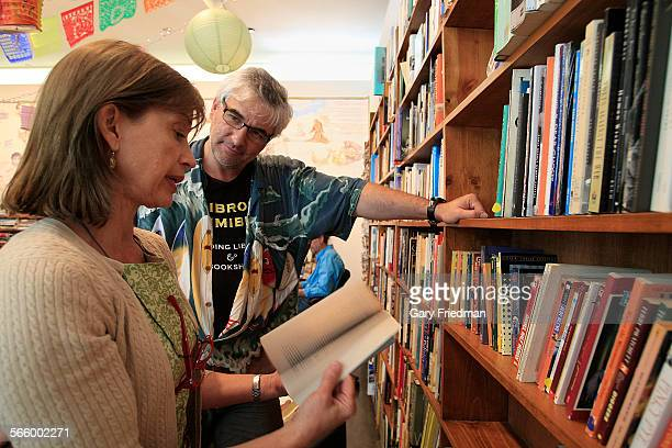 David Kipen assists Mary Brown at Libros Schmibros Lending Library and Neighborhood Book Store in the lobby of the Hammer Musum on August 31 2011...