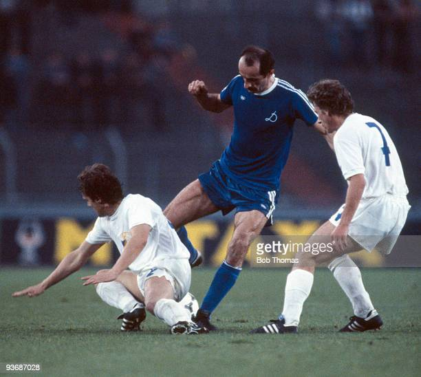 David Kipiani of Dynamo Tbilisi moves past Gerd Brauer and Andreas Krause of Carl Zeiss Jena during the Dynamo Tbilisi v Carl Zeiss Jena UEFA...