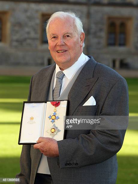David Kirch from Jersey holds his insignia after being invested as a Knight Commander of the Order of the British Empire for services as a...