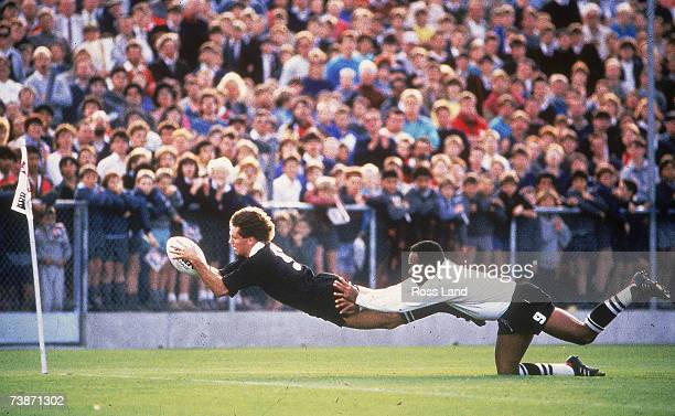 David Kirk of New Zealand dives to score a try in the corner during the 1987 Rugby World Cup Pool Three match between New Zealand and Fiji at...