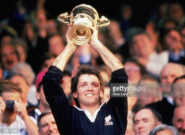 David Kirk of New Zealand lifts the Willam Webb Ellis Trophy after the 1987 Rugby World Cup Final match between New Zealand and France at Eden Park...