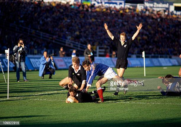 David Kirk of New Zealand touches down to score a Try despite the presence of Patrice Lagisquet of France during the Rugby Union World Cup Final held...