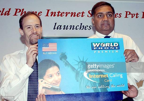 David Kleiman director of sales Asia Pacific Go2call and World Phone India Chairman Aditya Ahluwalia display a large mockup of a 'World Phone...