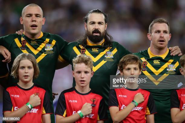 David Klemmer Aaron Woods and Michael Morgan of the Kangaroos sing the national anthem before the 2017 Rugby League World Cup Final between the...