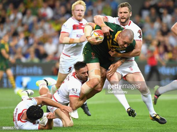 David Klemmer of Australia is tackled during the 2017 Rugby League World Cup match between the Australian Kangaroos and England at AAMI Park on...