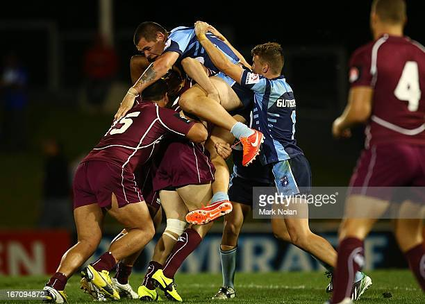 David Klemmer of New South Wales is tackled during the U20s State of Origin match between New South Wales and Queensland at Centrebet Stadium on...