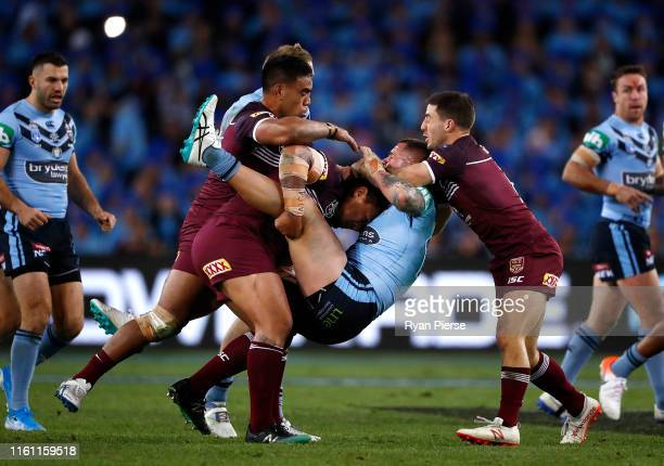 David Klemmer of the Blues is tackled by Josh Papalii of the Maroons during game three of the 2019 State of Origin series between the New South Wales...