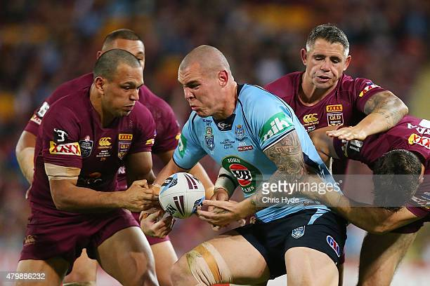 David Klemmer of the Blues is tackled during game three of the State of Origin series between the Queensland Maroons and the New South Wales Blues at...