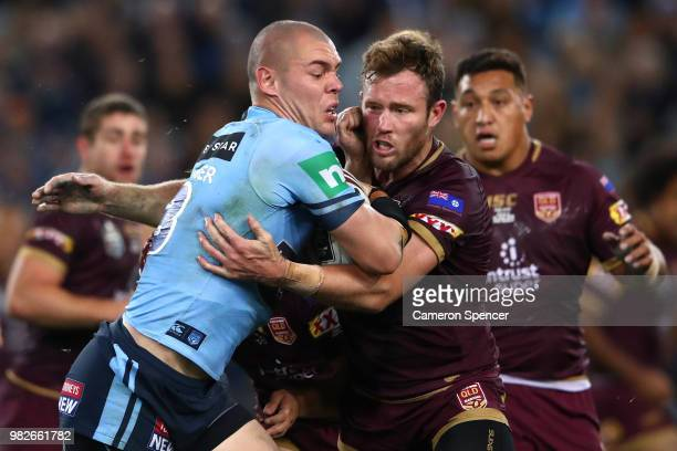 David Klemmer of the Blues is tackled during game two of the State of Origin series between the New South Wales Blues and the Queensland Maroons at...
