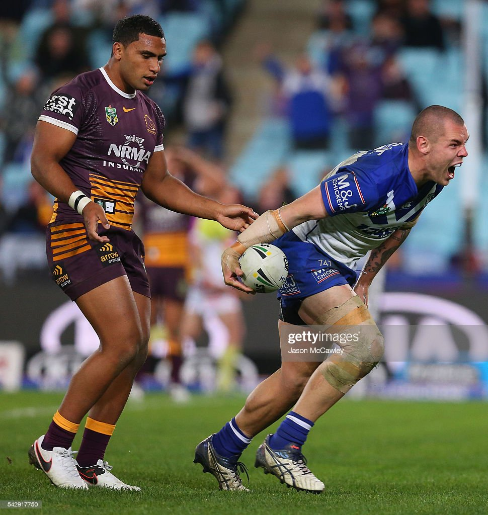 David Klemmer of the Bulldogs celebrates scoring a try during the round 16 NRL match between the Canterbury Bulldogs and Brisbane Broncos at ANZ Stadium on June 25, 2016 in Sydney, Australia.