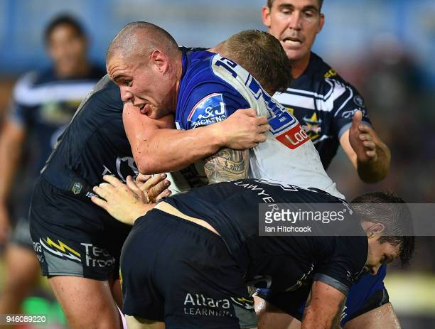David Klemmer of the Bulldogs is tackled by Ben Hampton and Coen Hess of the Cowboys during the round six NRL match between the North Queensland...