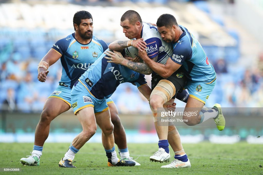 David Klemmer of the Bulldogs is tackled by the Titans defence during the round 25 NRL match between the Gold Coast Titans and the Canterbury Bulldogs at Cbus Super Stadium on August 26, 2017 in Gold Coast, Australia.