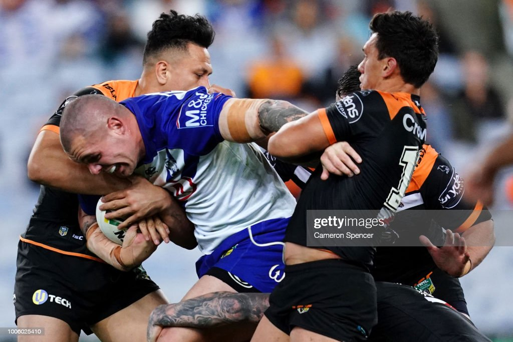 David Klemmer of the Bulldogs is tackled during the round 20 NRL match between the Canterbury Bulldogs and the Wests Tigers at ANZ Stadium on July 27, 2018 in Sydney, Australia.