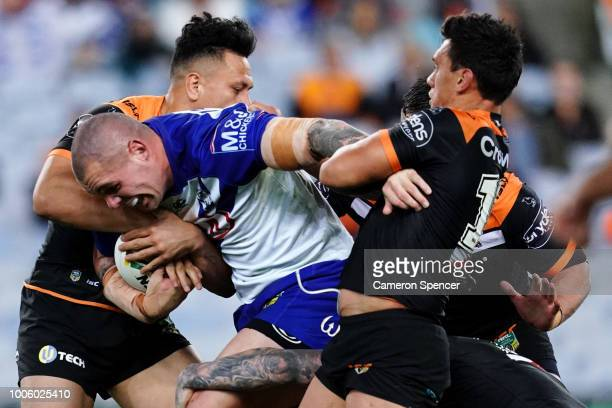 David Klemmer of the Bulldogs is tackled during the round 20 NRL match between the Canterbury Bulldogs and the Wests Tigers at ANZ Stadium on July 27...