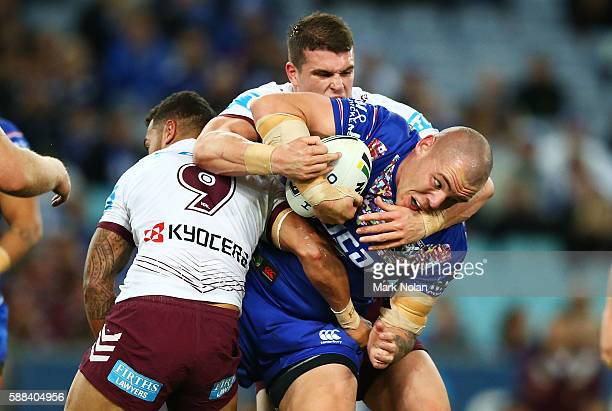 David Klemmer of the Bulldogs is tackled during the round 23 NRL match between the Canterbury Bulldogs and the Manly Sea Eagles at ANZ Stadium on...