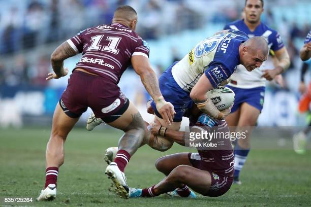 David Klemmer of the Bulldogs is tackled during the round 24 NRL match between the Canterbury Bulldogs and the Manly Sea Eagles at ANZ Stadium on...