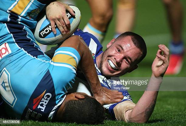 David Klemmer of the Bulldogs scores a try during the round 23 NRL match between the Canterbury Bulldogs and the Gold Coast Titans at Central Coast...