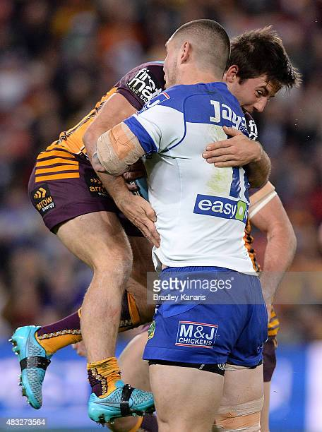 David Klemmer of the Bulldogs takes on the defence of Ben Hunt of the Broncos during the round 22 NRL match between the Brisbane Broncos and the...