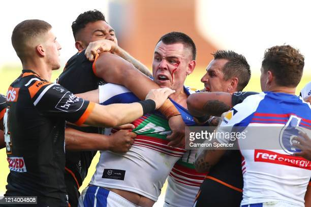 David Klemmer of the Knights has an altercation with Tigers players during the round 2 NRL match between the Wests Tigers and the Newcastle Knights...