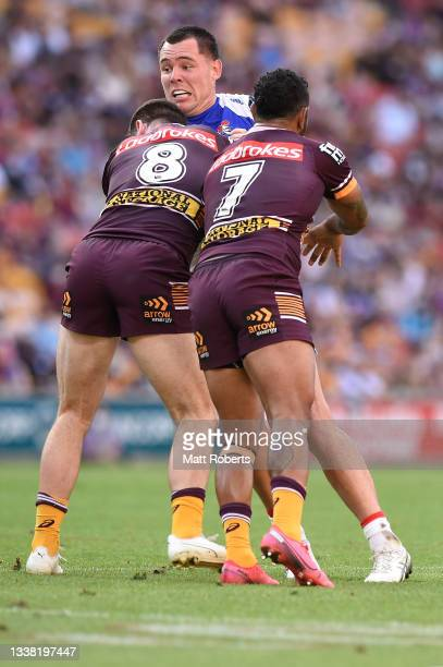 David Klemmer of the Knights is tackled during the round 25 NRL match between the Brisbane Broncos and the Newcastle Knights at Suncorp Stadium, on...