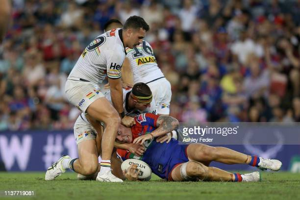 David Klemmer of the Newcastle Knights is tackled by the Panthers defence during the round two NRL match between the Newcastle Knights and the...