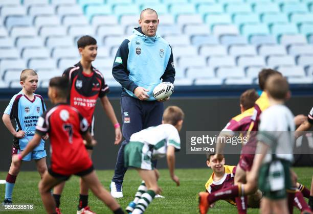 David Klemmer takes part in a juniors coaching clinic during the New South Wales Blues State of Origin Team Announcement at ANZ Stadium on July 2...