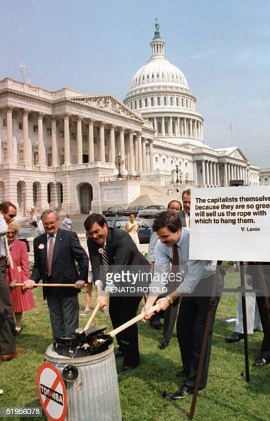 David Knee , chairman of the American Conservative Union, and his supporters destroy a Toshiba radio with sledgehammers 01 July 1987 on the Capitol...