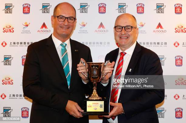 David Koch Chairman of the Power and Tony Cochrane Chairman of the Suns pose for a photograph with the 2017 Shanghai Cup during the Port Adelaide...