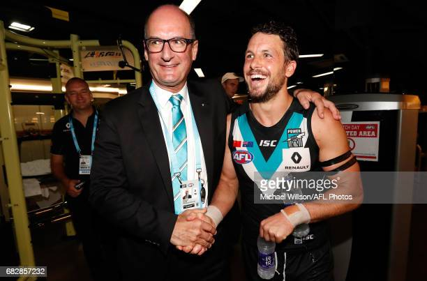 David Koch Chairman of the Power and Travis Boak of the Power celebrate during the 2017 AFL round 08 match between the Gold Coast Suns and Port...