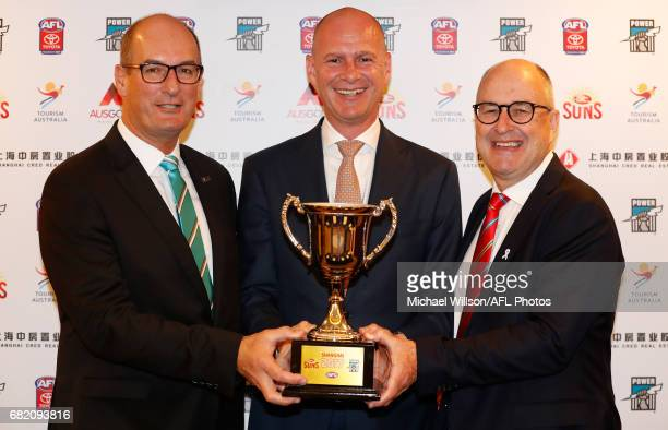 David Koch Chairman of the Power Andrew Hogg Tourism Australia Regional General Manager Greater China and Tony Cochrane Chairman of the Suns pose for...